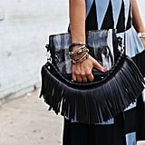An added chain strap detail of fringe that definitely doesn't disappoint.