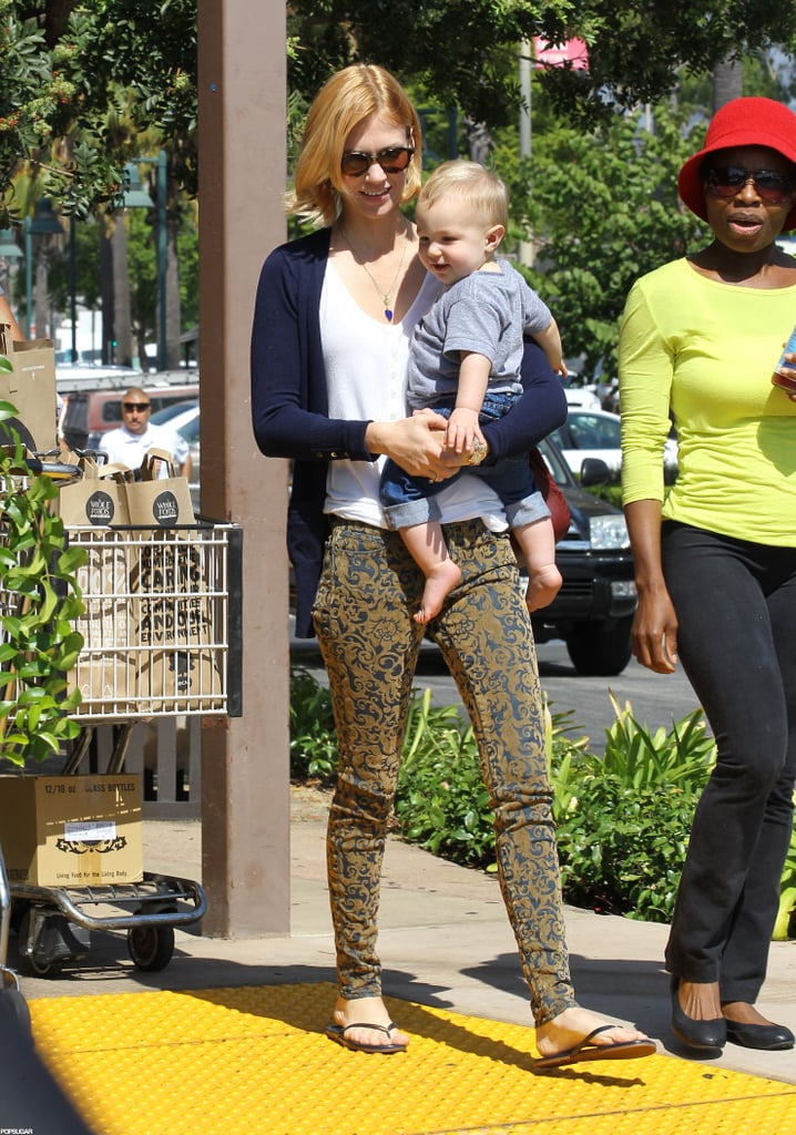 January Jones went shopping at a Whole Foods in Glendale, CA, with her son, Xander, yesterday. The duo got back to their weekday routine after an exciting weekend. January attended the Emmys in a dramatic black Zac Posen gown with her Mad Men costars Jon Hamm, Elisabeth Moss, and Christina Hendricks. The series was up for 17 awards, but didn't take home any wins. There was still cause for celebration, though, since Xander's first birthday fell just ahead of the annual show. January threw a car-themed BBQ for her little guy, and chatted about the event on the red carpet.