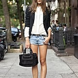 Give your cutoffs a Fall makeover with a blazer and autumnal accompaniments, like a hat and biker boots. Source: Le 21ème   Adam Katz Sinding