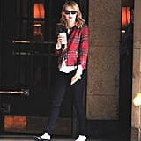 Emma Stone made a coffee run look totally chic with her black patent leather flats and plaid jacket.