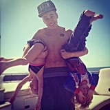 Justin Bieber showed off his muscles by lifting small children. Source: Instagram user justinbieber