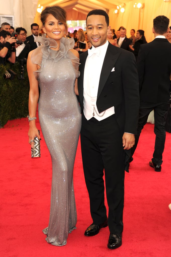 Chrissy Teigen showed quite a bit of skin when she arrived at the 2014 Met Gala at the Metropolitan Museum of Art in NYC on Monday with her husband, John Legend, by her side. She wore a one-of-a-kind Ralph Lauren Collection dress made with Swarovski crystals while John, in keeping with the night's white-tie dress code, wore a formal tuxedo with tails. This year's Met Gala will be the first event in the Metropolitan Museum of Art's newly renamed Anna Wintour Costume Center (formerly just the Costume Institute) and will celebrate the work of American-based designer Charles James. Charles was best known in the '40s and '50s for his glamorous ball gowns. Don't forget to check out the all-time best dressed guests from the Met Gala!