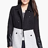 The contrast woven paneling and faux leather sleeves give this