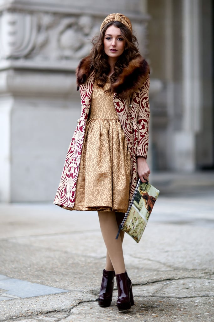 A decidedly opulent look with a fur collar, turban, and brocade layers.