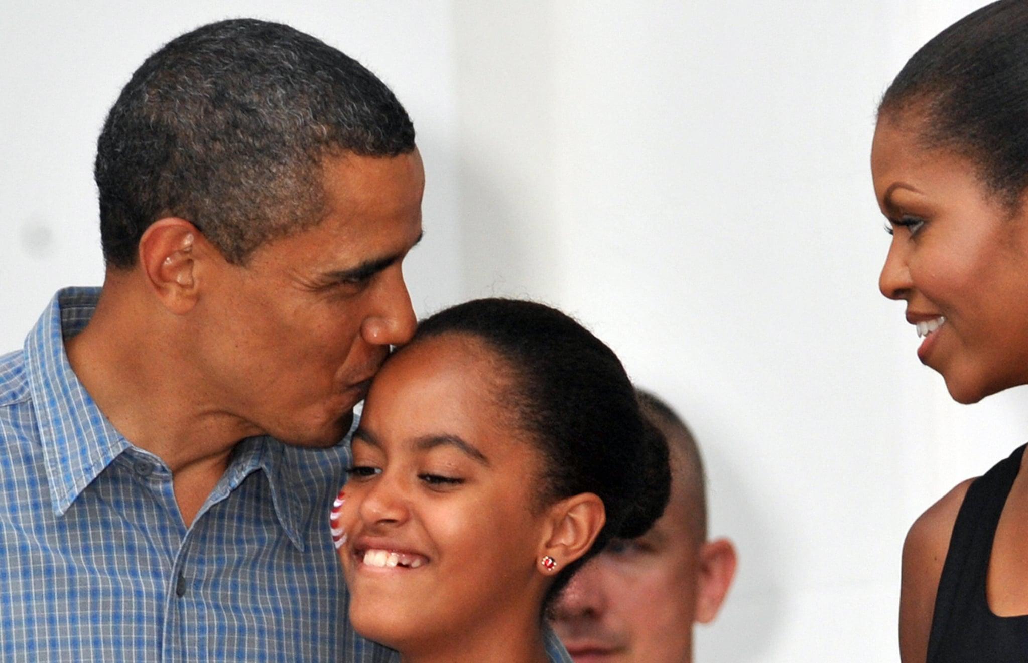 Barack gave Malia a sweet kiss on her birthday in 2009.