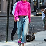 Gigi Kept Her Off-Duty Outfit Bright With a Magenta Sweater