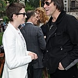 Anne Hathaway had a laugh with Jim Carrey the Stella McCartney presentation in NYC with Adam Shulman.
