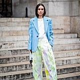A white tee give this bright blazer and printed pants outfit a low-key feel.