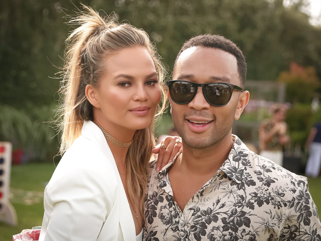 """Chrissy Teigen and John Legend sure know how to party! Over the weekend, the couple popped up at Revolve Clothing's annual Fourth of July BBQ pool party in the Hamptons, NY, and judging by these photos, they had a whole lot of fun. Clad in a sexy one-piece swimsuit, Chrissy — who served as the host of the bash — hit the pool with John and rode around on fun inflatables before meeting up with fellow model Emily Ratajkowski. The pair also took to Instagram to share photos from the fete, including one where Chrissy revealed she can't swim. This is just the latest we've seen of the famous duo since their slew of fun date nights last month, though Chrissy did recently appear in Fergie's sexy """"M.I.L.F. $"""" video alongside pal Kim Kardashian. Read on for more pictures, then get a sweet peak at John and Chrissy's beautiful daughter Luna."""