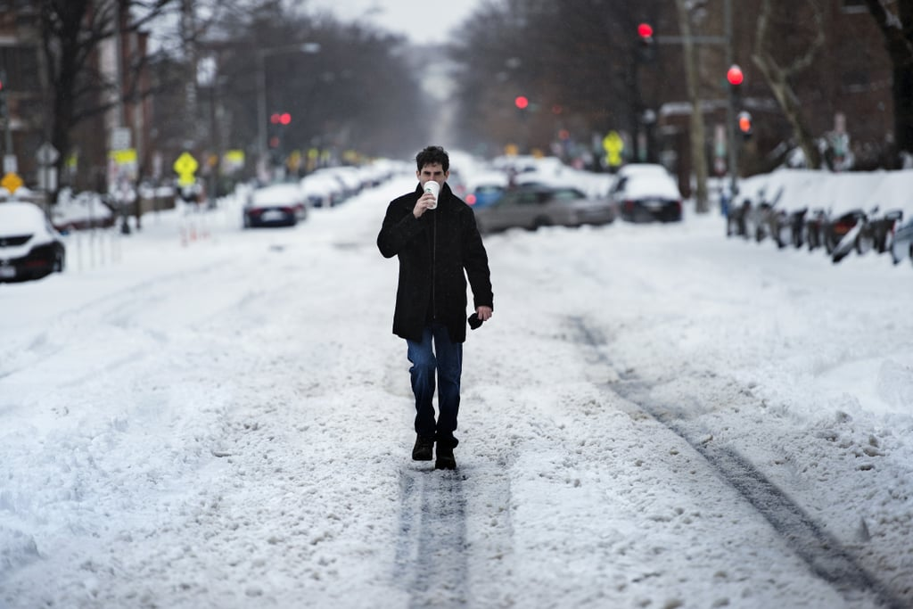 One man made his way down the center of a Washington DC road, coffee in hand.