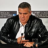 George Clooney wore another leather jacket to a press conference.