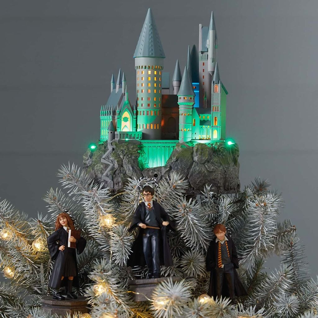"Summer might still be in the air, but it's Christmastime at Hogwarts year-round, and we're ready to decorate with floating candles, snow charms, and this absolutely brilliant Hogwarts Castle Musical Tree Topper by Hallmark.  While it may look a little big to be a tree topper (it's over nine inches tall), rest assured that even the most novice witches and wizards can keep the Hogwarts replica atop their trees by casting a simple levitation spell (""wingardium leviosa""). Most magical of all? With just the press of a button flick of your wand, this enchanting tree topper will play ""Hedwig's Theme,"" and I can already smell the treacle tarts and pumpkin pasties.  Available online on Hallmark's website, this Harry Potter Collection Hogwarts Castle Musical Tree Topper With Light ($120) is ideal for Gryffindors, Ravenclaws, Hufflepuffs, and Slytherins alike. The inside of the castle even changes colour on rotation! (The description will tell you a power adapter and a light bulb are responsible for the continuous colour-changing effect, but I suspect some serious spell casting took place here.) As with almost anything Harry Potter-related, this miniature Hogwarts castle also has a secret to be unlocked. When plugged in, the castle reacts to the presence of other ornaments from the Hallmark Harry Potter Collection, unlocking special, interactive performances featuring Ron, Hermione, and Harry himself! See the bewitching castle in action ahead, and prepare to hum ""Hedwig's Theme"" to yourself from now through Christmas.       Related:                                                                                                           Ho Ho Hold Up! Disney Just Dropped Its 2019 Holiday Ornament Collection"
