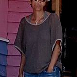 Halle Berry tucked one hand in her pocket.