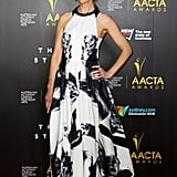 Kat Stewart's halter gown gave us instant wardrobe envy. We love Every Little Thing about it: from the voluminous, lengthy skirt, to the sleek cut-away neckline.