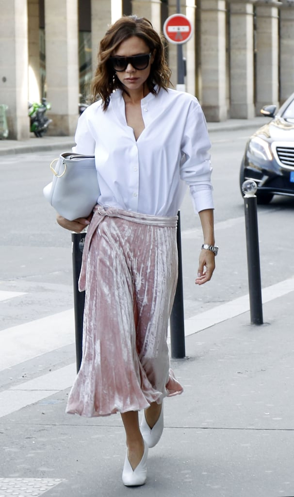 Victoria Wearing Her Heels With a Pink Velvet Skirt and Button-Down