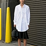 Minimalist perfection in an oversize white shirt and leather skirt.