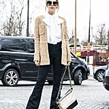 A Pretty White Blouse, a Beige Coat, and Black Flared Jeans