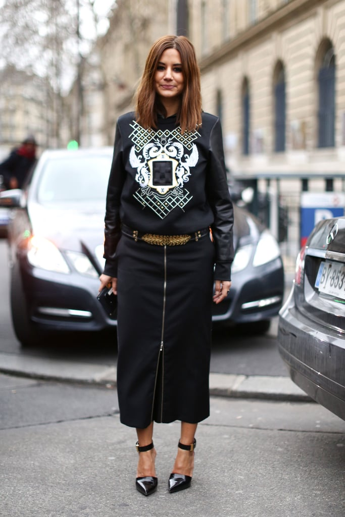 Christine Centenera worked her signature edgy brand of chic in a zippered pencil skirt and printed sweatshirt.
