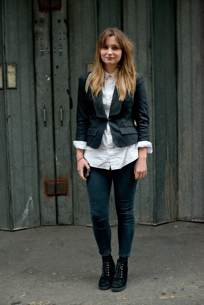 Classic on top, thanks to a white-button down and blazer, and casual on the bottom with lace-up booties and skinny denim.