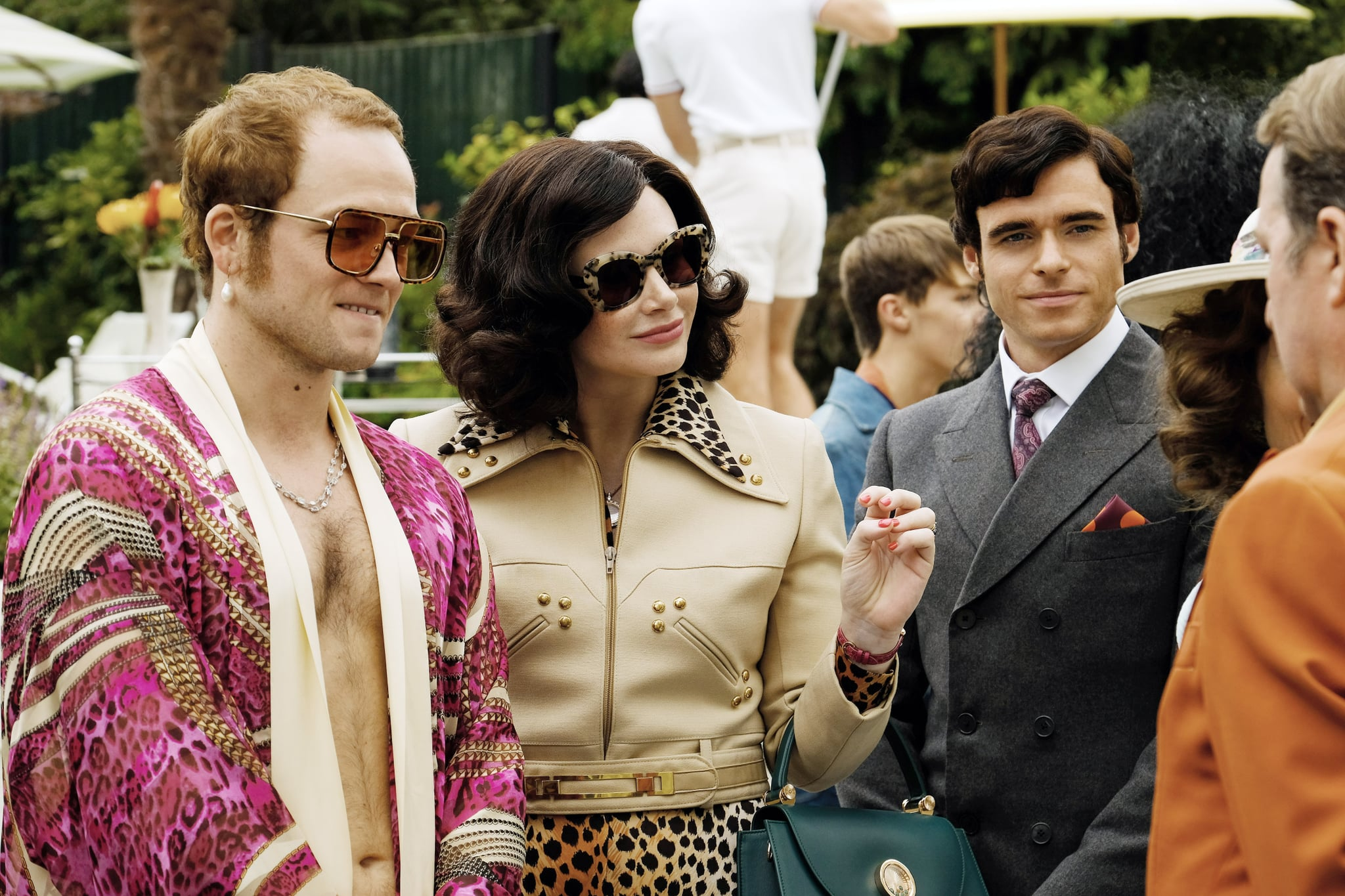 ROCKETMAN, from left: Taron Egerton as Elton John, Bryce Dallas Howard, Richard Madden, 2019. ph: David Appleby /  Paramount / Courtesy Everett Collection