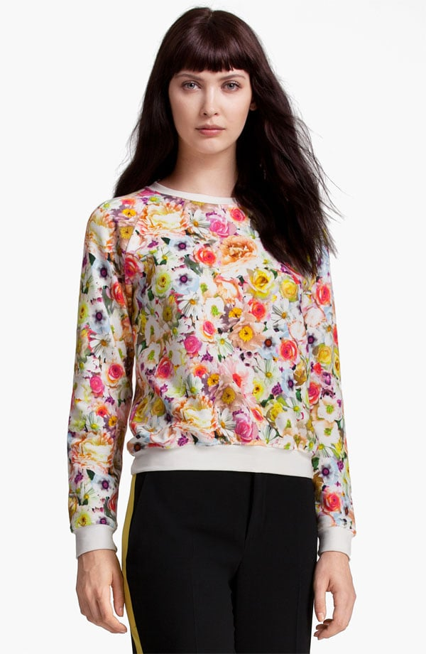This MSGM floral sweater ($350) — currently on presale — is gorgeously girlie, but we adore that the contrast neckline and hem gives it a sporty edge. It would come to life with everything from denim to leather, but we most love it with a black pencil skirt and pumps.