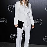 Fergie flew to Milan to take in the Giorgio Armani show wearing a crisp white suit finished with black touches, including a pair of nerdy glasses, an oversize clutch, and pointy pumps.