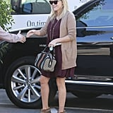Reese Witherspoon shook hands with a fan.