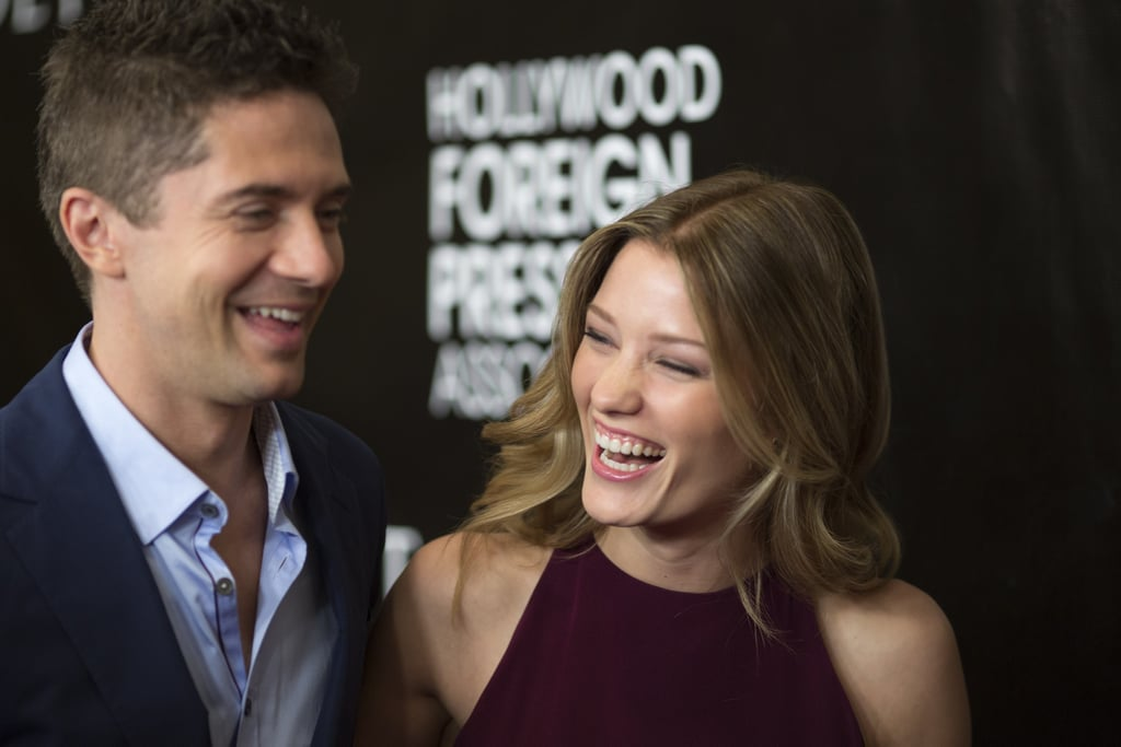 Topher Grace and Ashley Hinshaw cracked each other up when they hit the red carpet together at the Hollywood Foreign Press Association's Grants Banquet in LA on Thursday. Topher had his arm around his fiancée as they posed for pictures, at one point flashing a big grin while she laughed. Since Topher proposed to Ashley in January, the pair has been busy with work. Ashley appeared on the small screen as Lacey in True Detective, which just wrapped its second season, and Topher stars in the upcoming movie American Ultra with Kristen Stewart and Jesse Eisenberg. Keep reading for all their cutest moments on the red carpet!