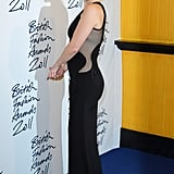 Kate Hudson dressed in a sexy black dress for a fashion party.