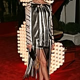 Leg-revealing slits in a slinky, striped mini at a Dolce & Gabbana party in '06.