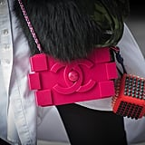 It may be small, but this little Chanel clutch packs a punch with its notice-me hue.