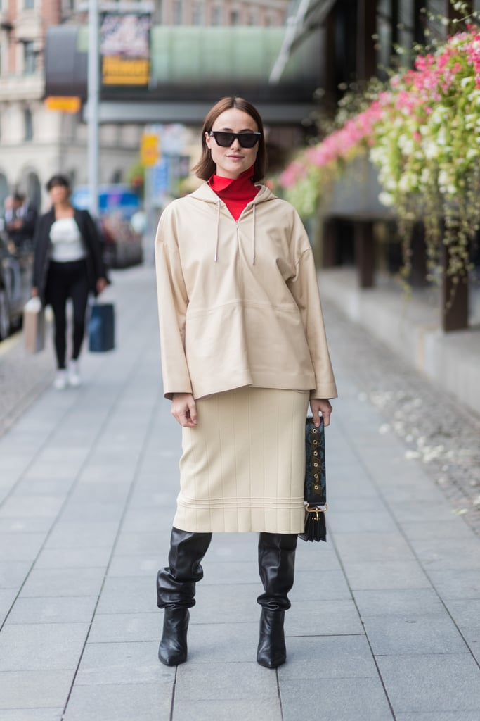 Let a Knee-Length Skirt Fall Beyond Slouchy Knee-High Boots