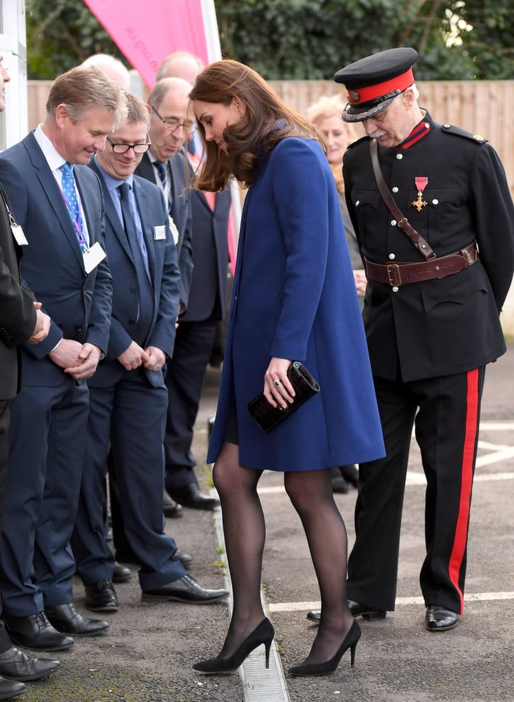 """Kate Middleton may be a duchess, but that doesn't mean she's immune from some of life's little annoyances, like, say, getting your high heel stuck in a grate. While opening an Action on Addiction community treatment centre on Wednesday in Wickford, Kate — clad in a royal blue coat — was making her way to greet a group of waiting staff members and healthcare professionals when the heel of her black suede shoe got caught in a small grate; like a true professional, the pregnant duchess pulled it out and carried on her with her royal duties. Inside, she was all smiles while sitting on a round-table discussion with clients at different points in their recovery.  Action on Addiction is just one of the many charities that Kate is patron of. According to its chief executive, Nick Barton, Kate chose it """"because she had realised that with many problems faced by young people, the trail always led back to addiction of some sort."""" Keep reading to see Kate making the most of her shoe snafu, then check out all the ways she's been thriving during her third pregnancy.      Related:                                                                                                           9 Times The Duchess of Cambridge's Outfit Was No Match For a Gust of Wind"""