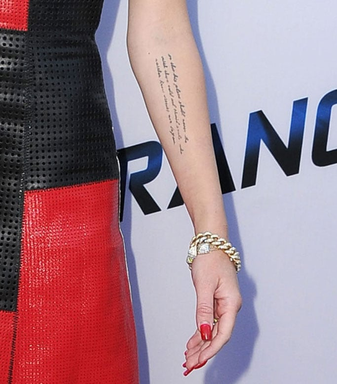 cebe7bafe In 2012, Miley and boyfriend Liam Hemsworth got coordinating tattoos on  their left arms of