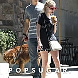 Justin Long held onto the dog leash while Amanda Seyfried held a drink.