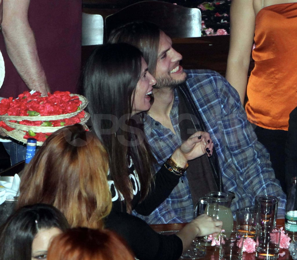 Ashton Kutcher cozied up to a brunette woman during a night out in Athens last week. The duo partied with friends at a club and practiced the Greek tradition of throwing carnations at performers. Ashton popped up in Greece after spending time in Rome, where he was photographed with Lorene Scafaria. Ashton and Lorene insist that they are just friends and that their recent outings are due to the fact that they are working on a project together. Ashton's split from Demi Moore was one of the biggest headlines of 2011 and it looks like both parties are taking advantage of a fresh start in the New Year. Ashton produced the revamp of Punk'D debuting in March while Demi has a cameo in Lovelace, the biopic about adult star Linda Lovelace.