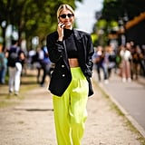 Fearless fashion-forward dressing looks like this: a pair of citron-hued high-waist pants meant to stand out.