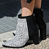 Two-tone versatile booties to be worn for all seasons.
