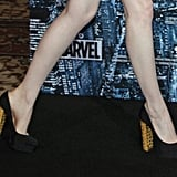 Now, this is a serious gilded shoe statement. Emma's gold-heeled Christian Louboutin pumps souped up her minimalist Martin Grant LBD on top.