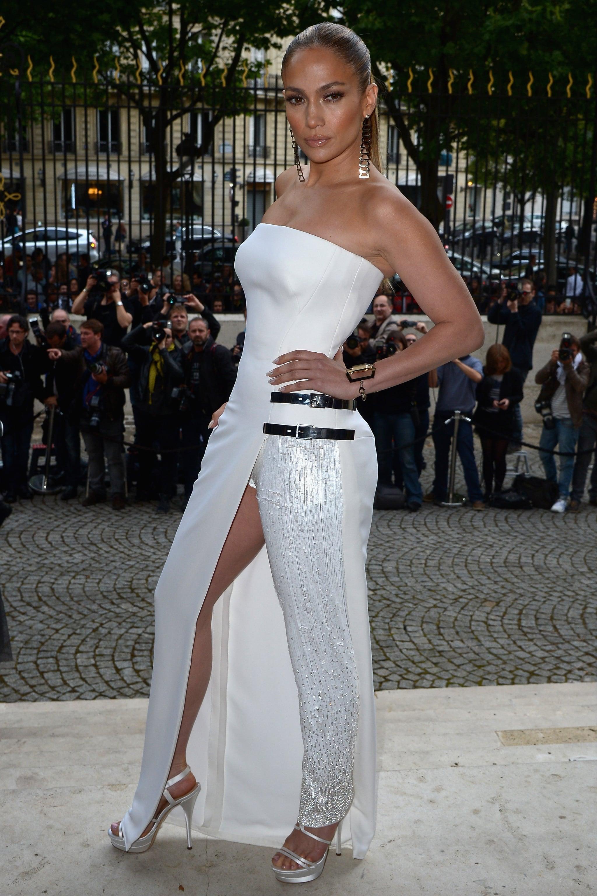 During Paris Haute Couture Fashion Week 2014, Jennifer struck a pose in a dress/pants Versace hybrid.