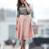 A midi skirt with a tucked-in tee