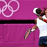 US tennis players and sisters Serena Williams and Venus Williams hugged after winning gold.