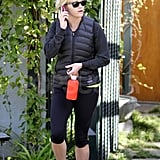 Reese Witherspoon carried a red water bottle.