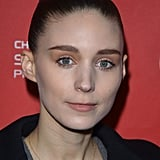 A sleek bun and a neutral makeup palette finish off Rooney Mara's effortlessly chic getup.