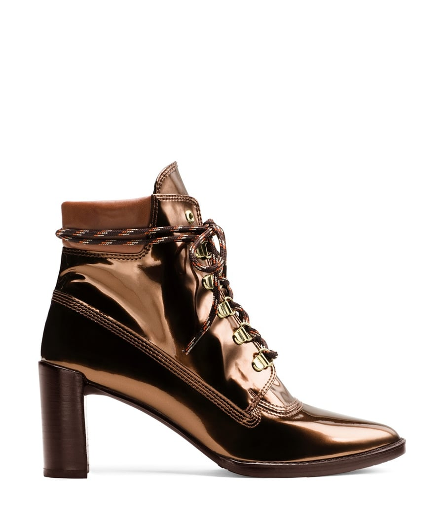 """""""After seeing the Gigi Hadid x Stuart Weitzman Collection, I knew I wanted a pair of the Gigi Boot in Copper ($565). The metallic shine, lace-up details, and pointy toe make for a cool Fall bootie. And if you need another reason to buy them: Gigi designed them!"""" — ML"""