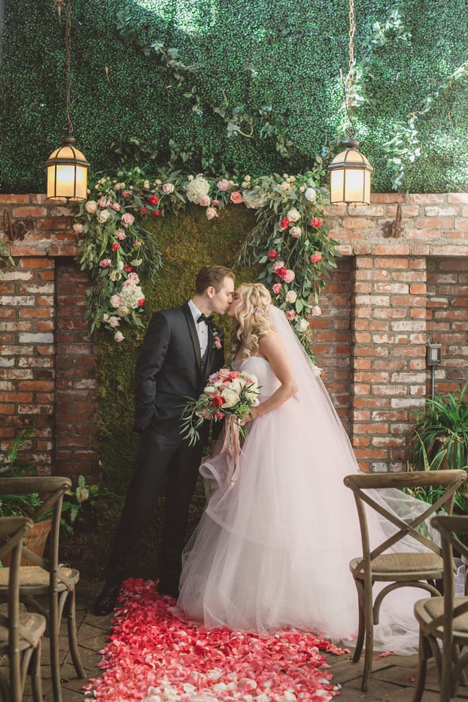 "Say ""I do"" in front of a floral wreath . . ."