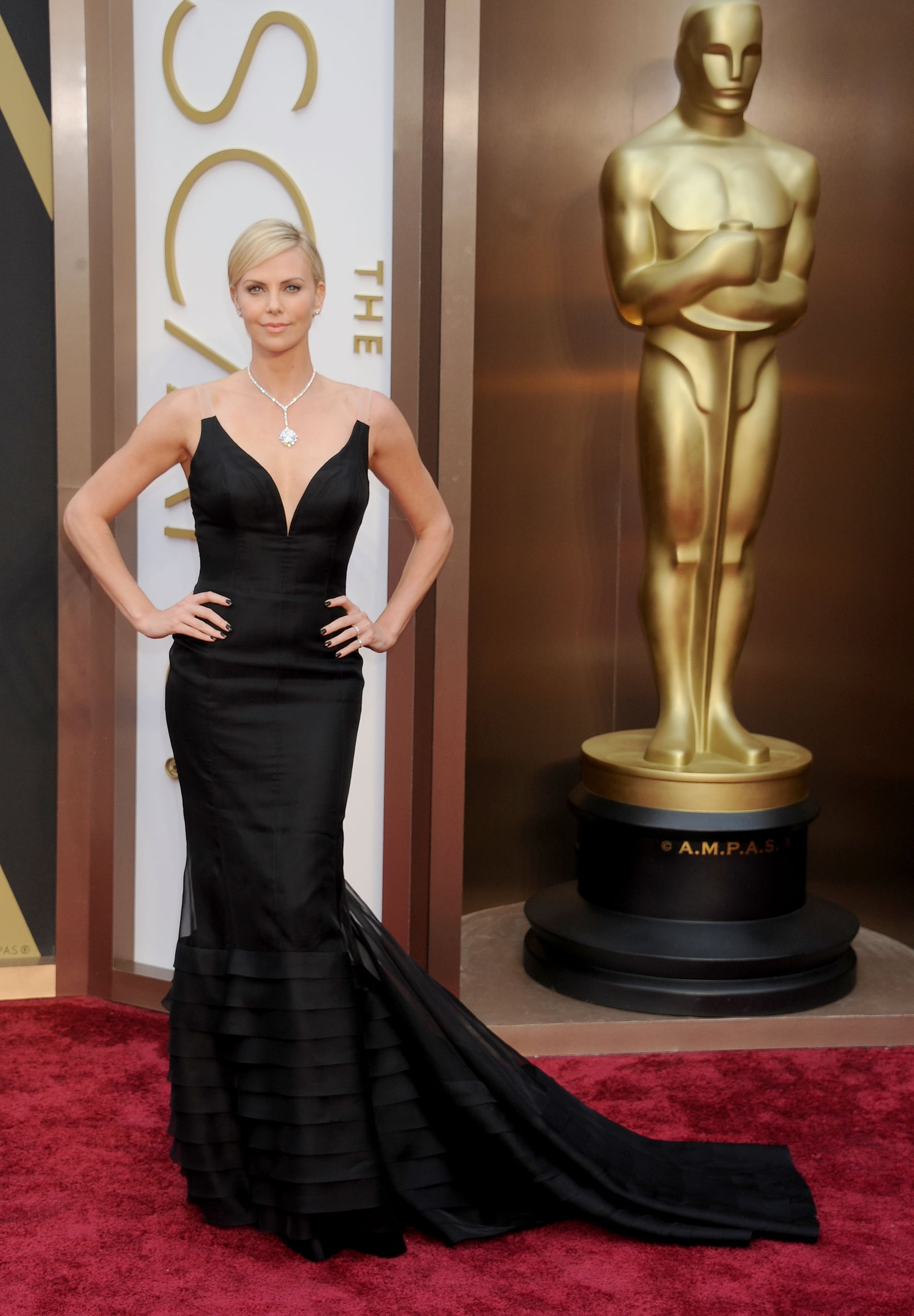 Charlize took the Academy Awards red carpet in this jaw-dropping, sheer-overlay Dior gown. It was certainly one of her most memorable fashion moments, as she soared to the top of best-dressed lists without the help of a bright color.