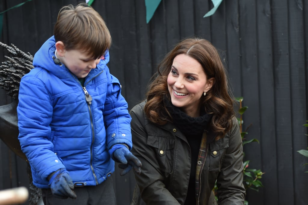 """Nothing warms our hearts more than seeing the Duchess of Cambridge with kids, and on Wednesday, the duchess visited London's Robin Hood Primary School to celebrate 10 years of The Royal Horticultural Society's campaign for school gardening. The organisation is the world's leading gardening charity, and during Kate's visit, she was able to see firsthand how students have benefited from the campaign. Kate also showed off her green thumb as she joined kids in planting bulbs and whittled sticks to make bug nests.        Related:                                                                                                           Wait a Tick — Is the Duchess of Cambridge Having Twins?               Just the day before, Kate stopped by the Foundling Museum, where she did some arts and crafts with local nursery kids and gushed about Prince Harry's recent engagement to Meghan Markle. """"William and I are absolutely thrilled. It's such exciting news,"""" she told reporters. It's a really happy time for any couple and we wish them all the best and hope they enjoy this happy moment."""""""