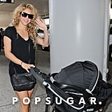 Shakira waved to photographers when she arrived at LAX on Thursday.