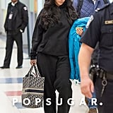 Rihanna Carrying Her Monogrammed Dior Tote Bag Through JFK Airport